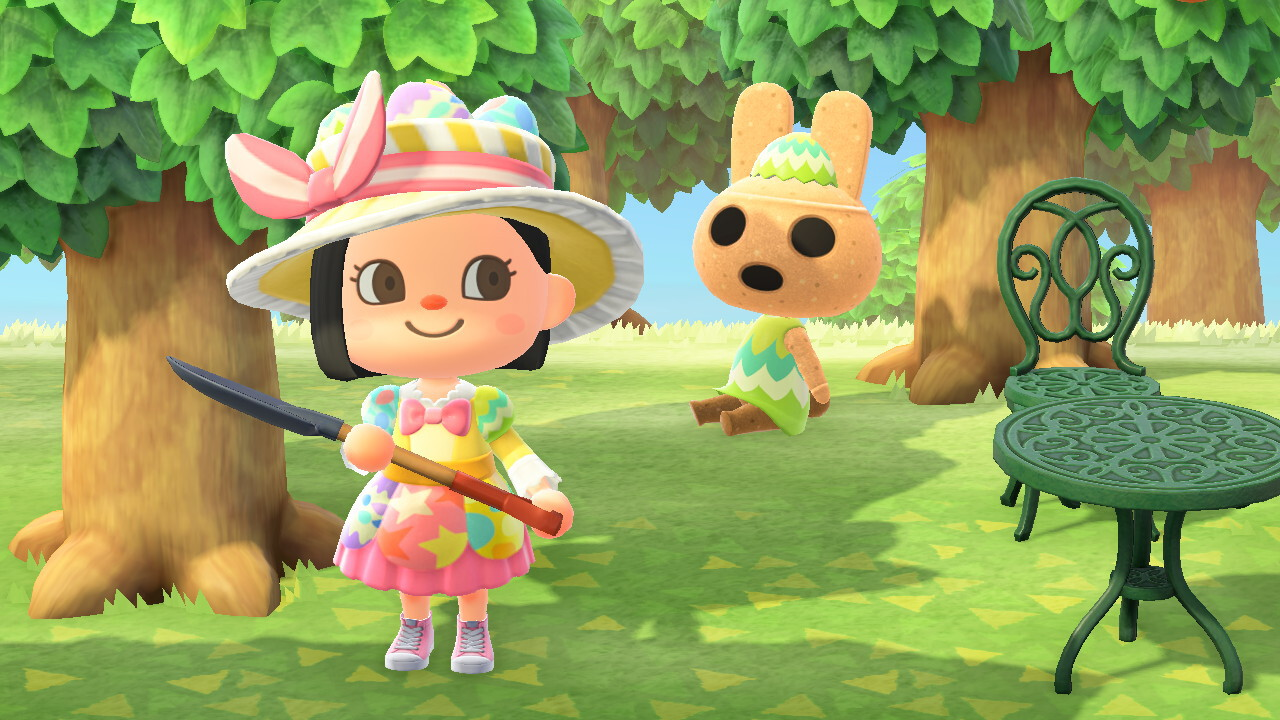 An Animal Crossing: New Horizons screenshot. My character stands in her Bunny Day outfit, holding a shovel. Nearby, Coco kind of looks like a gyroid rabbit (based on real-life haniwa), with a baked clay texture and adorably terrifying eyes and a mouth that seem to be circles of absolute nothingness. She's wearning a green Bunny Day dress and hat.