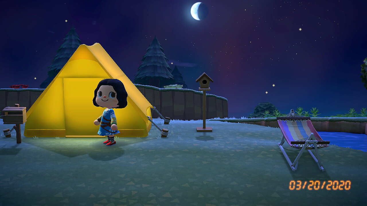 An Animal Crossing: New Horizons screenshot. It's evening, and my character stands in front of the lit tent. A birdhouse and a cot, just a couple of humble pieces of furniture, stand nearby. The timestamp in the corner reads 03/20/2020.