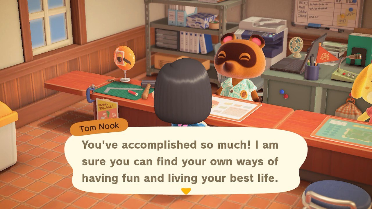 "A screenshot from Animal Crossing: New Horizons. Tom Nook sits behind his counter in resident services. ""You've accomplished so much! I am sure you can find your own ways of having fun and living your best life."""