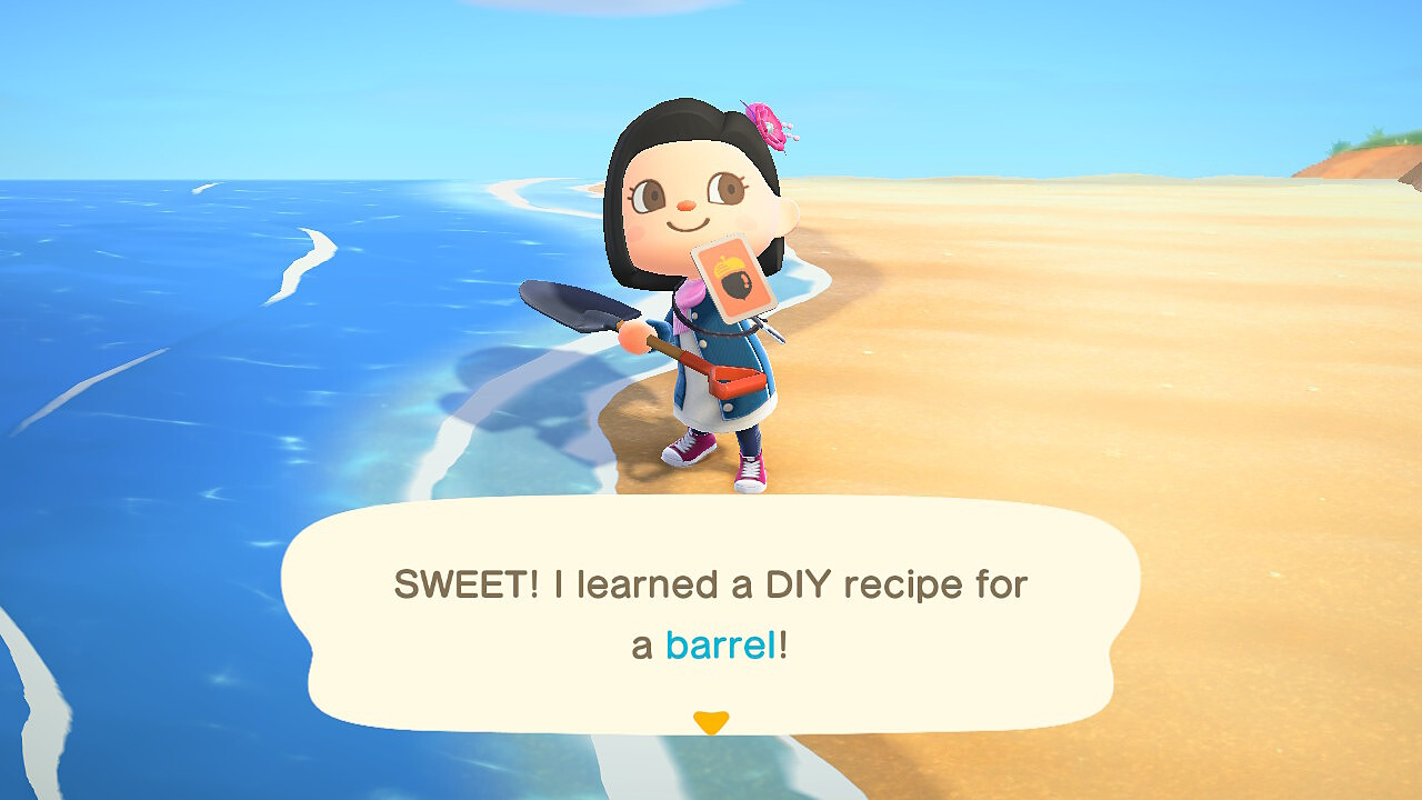 "A screenshot from Animal Crossing: New Horizons. My villager holds up a DIY recipe on the beach. ""SWEET! I learned a DIY recipe for a barrel!"""